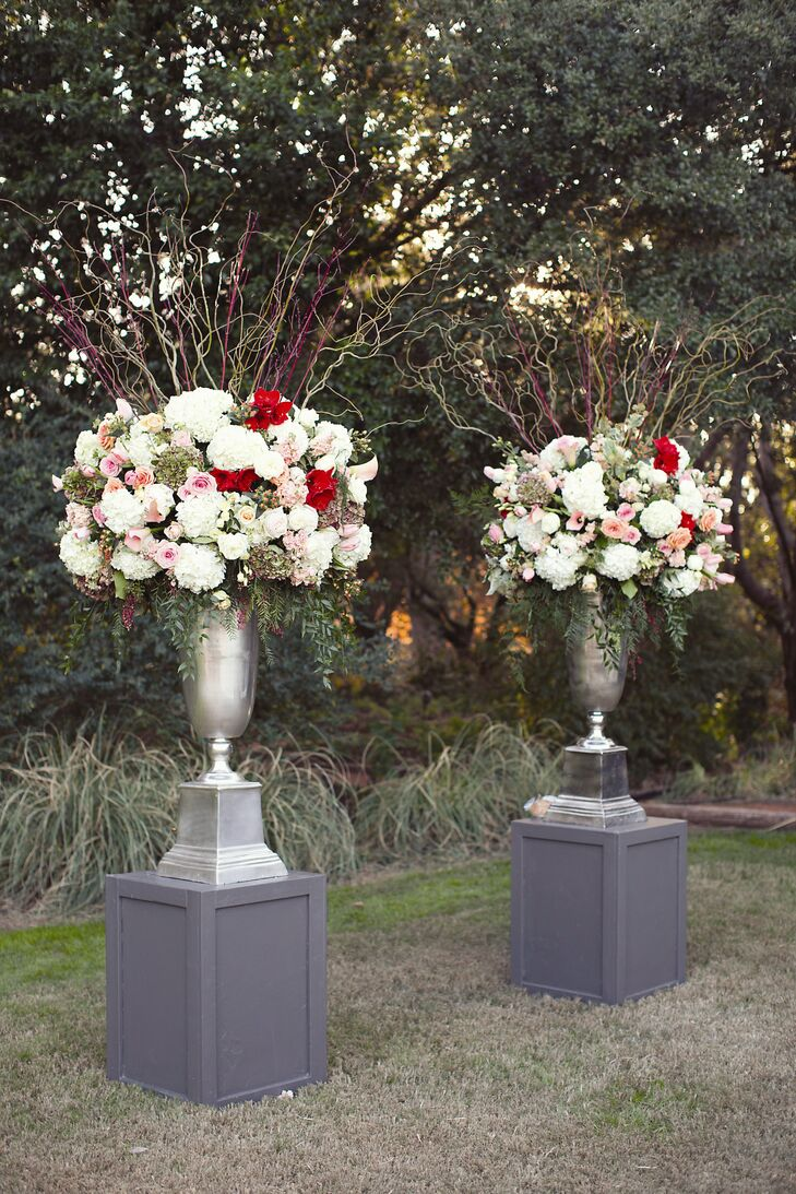 The large, romantic ceremony flowers were displayed in giant silver vases and featured a lovely arrangement of hydrangeas, sweet peas, tulips and roses.