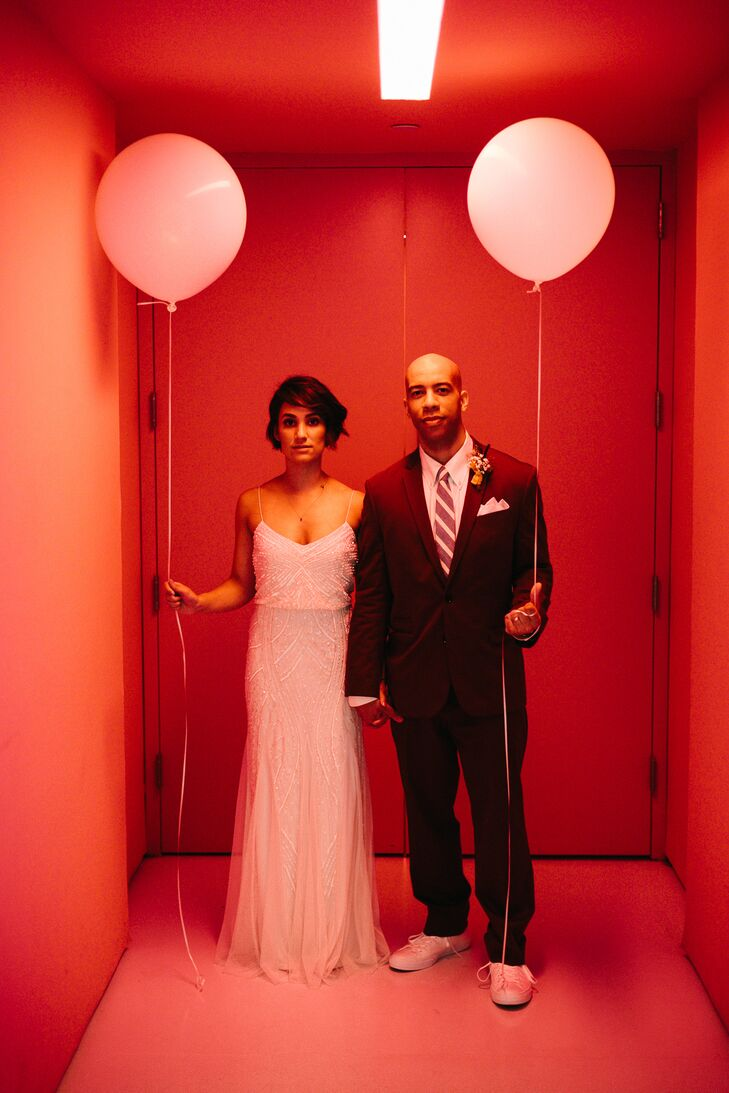 Traditional was out of the question for Liz and Adam when it came to matters of style. The couple took the modern route, with Liz donning a sophisticated sheath BHLDN gown with intricate beading and Adam sporting a burgundy suit and a striped tie.