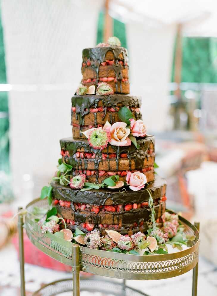 For dessert, the couple cut into a naked cake filled with fresh strawberries and chocolate ganache.