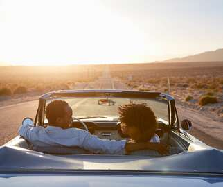 Couple in car on honeymoon road trip