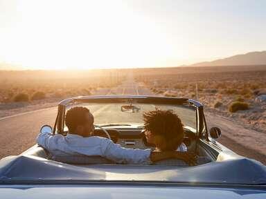 Couple in car on honeymoon road trip