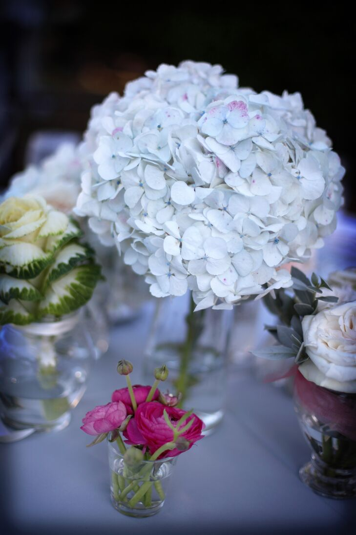 Each table at Lindsay and Derek's reception had an arrangement of white hydrangea and peach roses as the centerpiece.