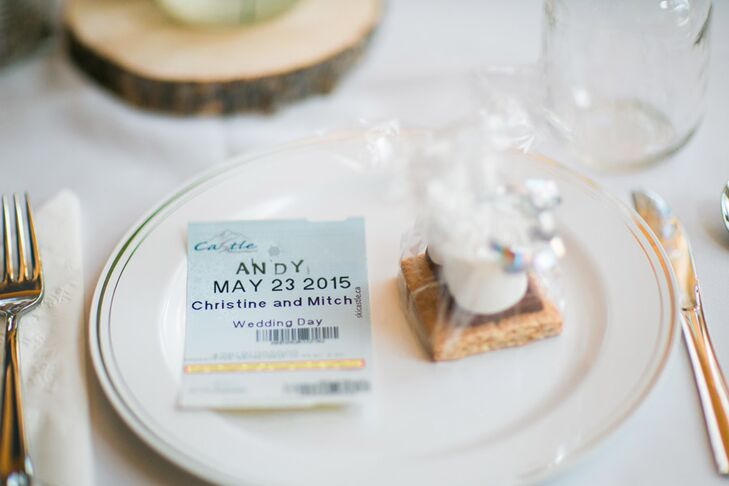 The escort cards were designed to resemble lift tickets for Castle Mountain. As wedding favors, Christine and Mitch gave their guests DIY s'mores packages that they could enjoy at the bonfire that took place in the backyard after dinner.