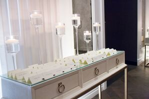 Neutral, Modern Escort Card Display with Floating Candle Décor