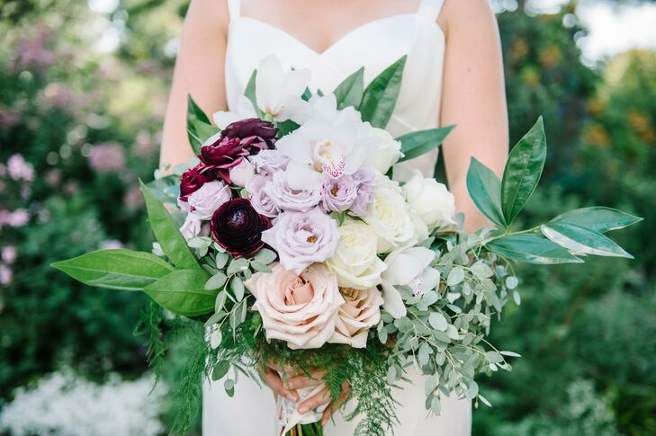 To match the garden surroundings, Allison carried a loose bouquet in romantic shades of peach, lavender, ivory and burgundy. The flower arrangement included roses, lisianthus, ranunculus, eucalyptus leaves and other greens.