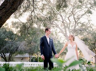 "Glori	Thompson wed Will Marshall in the backyard of her childhood home. ""Our style is traditional and classic with an infusion of color and excitement"