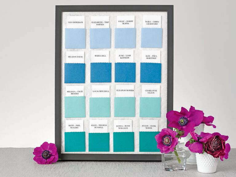 Ombre blue escort card display board with envelopes