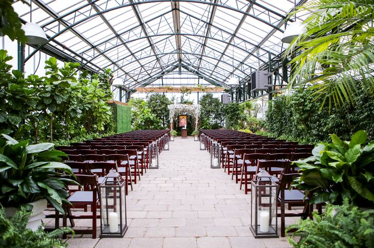 """You felt like you were in a tropical garden,"" Katina says of their ceremony space at Planterra Conservatory in West Bloomfield, Michigan."