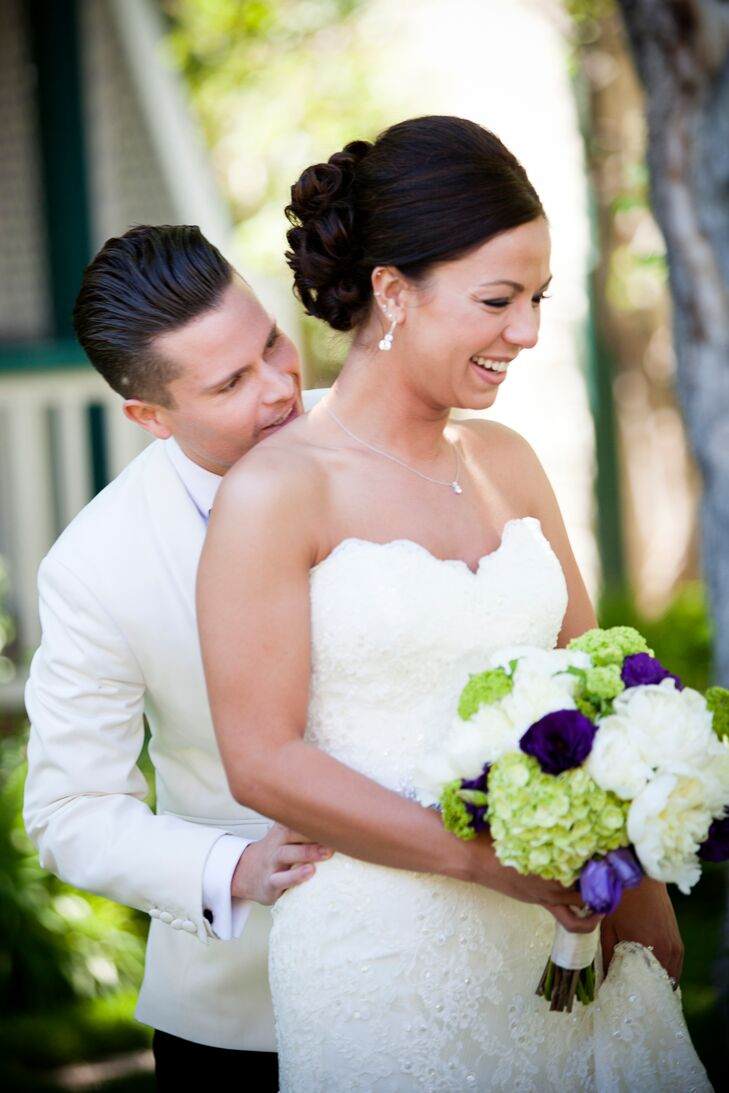 """The bride carried a white, purple and green bouquet, including white peonies and green viburnum. """"The flowers were chosen because of a connection to my grandmother and what she grew in her yard,"""" says the bride."""