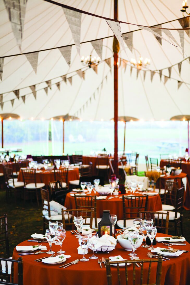 Alli and Joel wanted everything in their wedding to be as local, reused, recyclable and antique as possible. Joel spent three months making over 1,000 newspaper pennants for the reception décor!