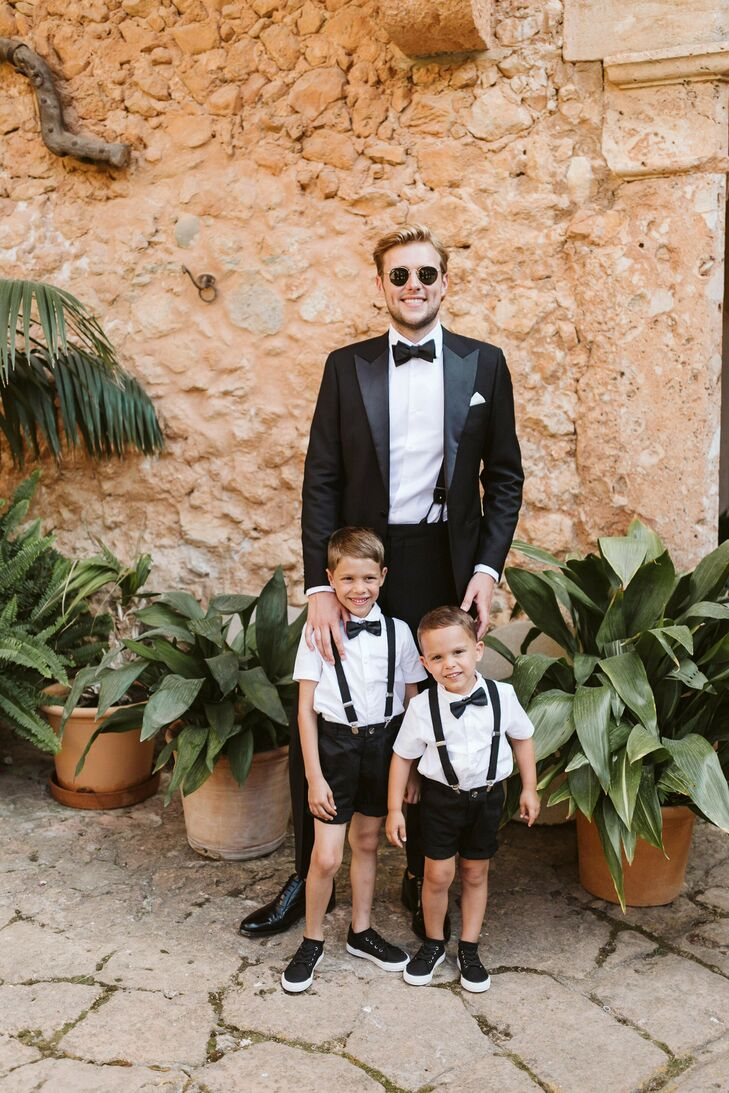 Groom Poses with Ring Bearers at Finca Es Cabas in Mallorca, Spain