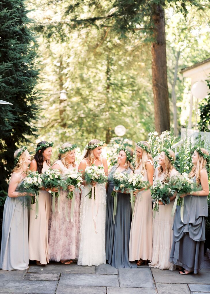 """My bridesmaids are all so beautiful and stylish. I thought it would be a crime to put them all in the same dress—especially since one of my ladies was carrying a baby at 8.5 months."" Isabella says. The bride gave her ladies a palette of gray, nude and dusty pink and asked them to find a floor-length gown that made them feel fabulous. ""They came back with a gorgeous array of dresses, and the palette looked amazing on everyone."""