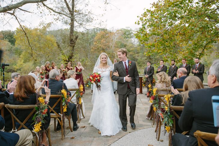 "Gail and Adam said ""I do"" on the outdoor patio at Darby House in Galloway, Ohio, surrounded by natural vegetation and fall foliage."
