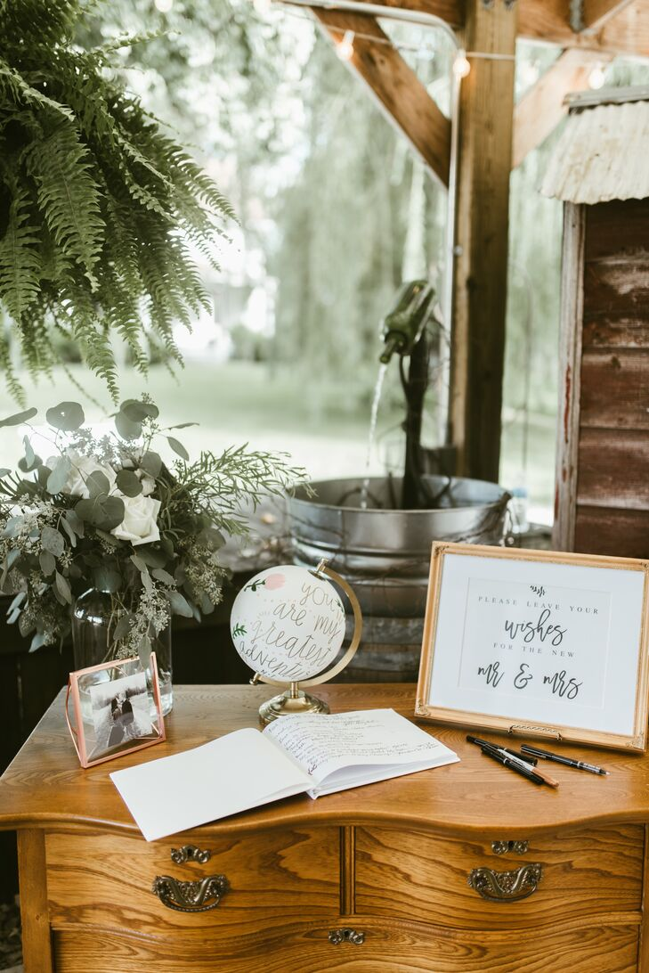 A vintage bureau once owned by a relative of the groom served as the guest book table.
