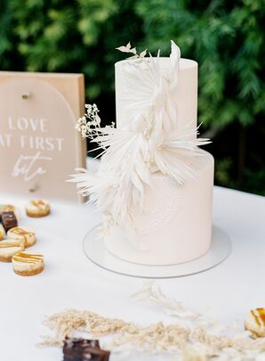 Two-Tier White Cake With Dramatic Textured Decorations