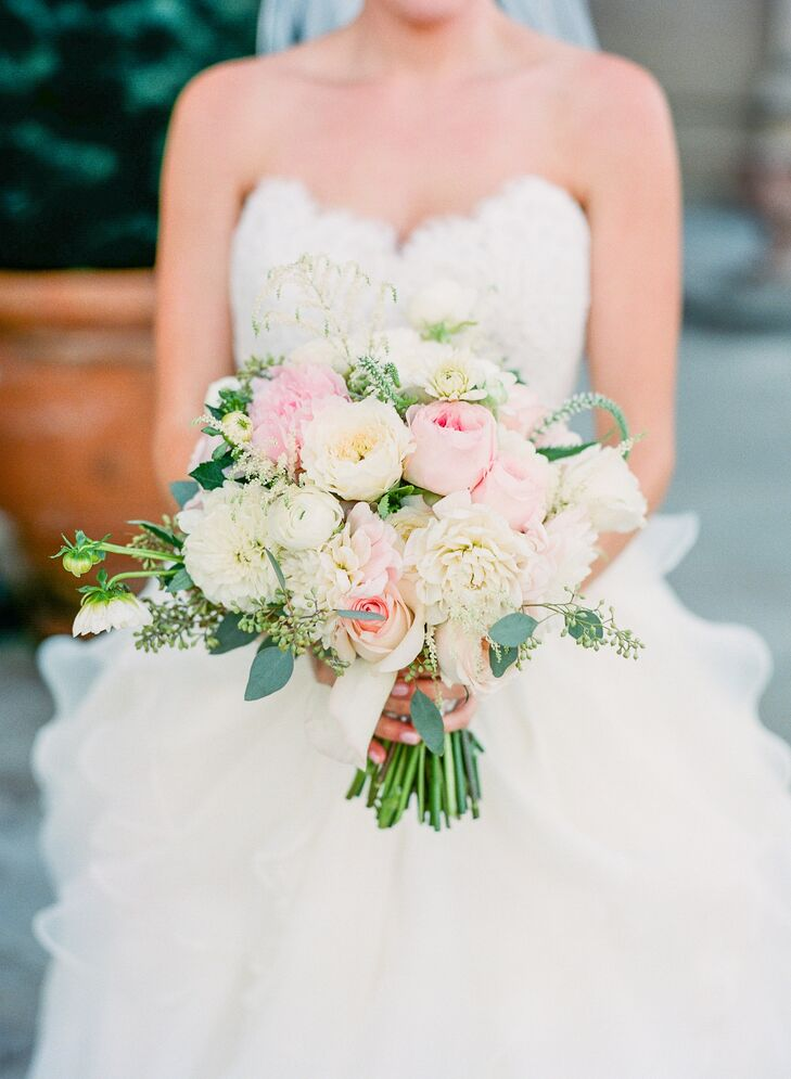 For a classic-yet-whimsical ambiance, the couple worked with a romantic color palette of ivory, pink and gold.