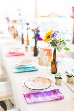 Sunflower Centerpieces with Colorful Dyed Linens