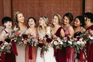 Bohemian Bridesmaids with Mismatched Red Dresses and Moody Bouquets