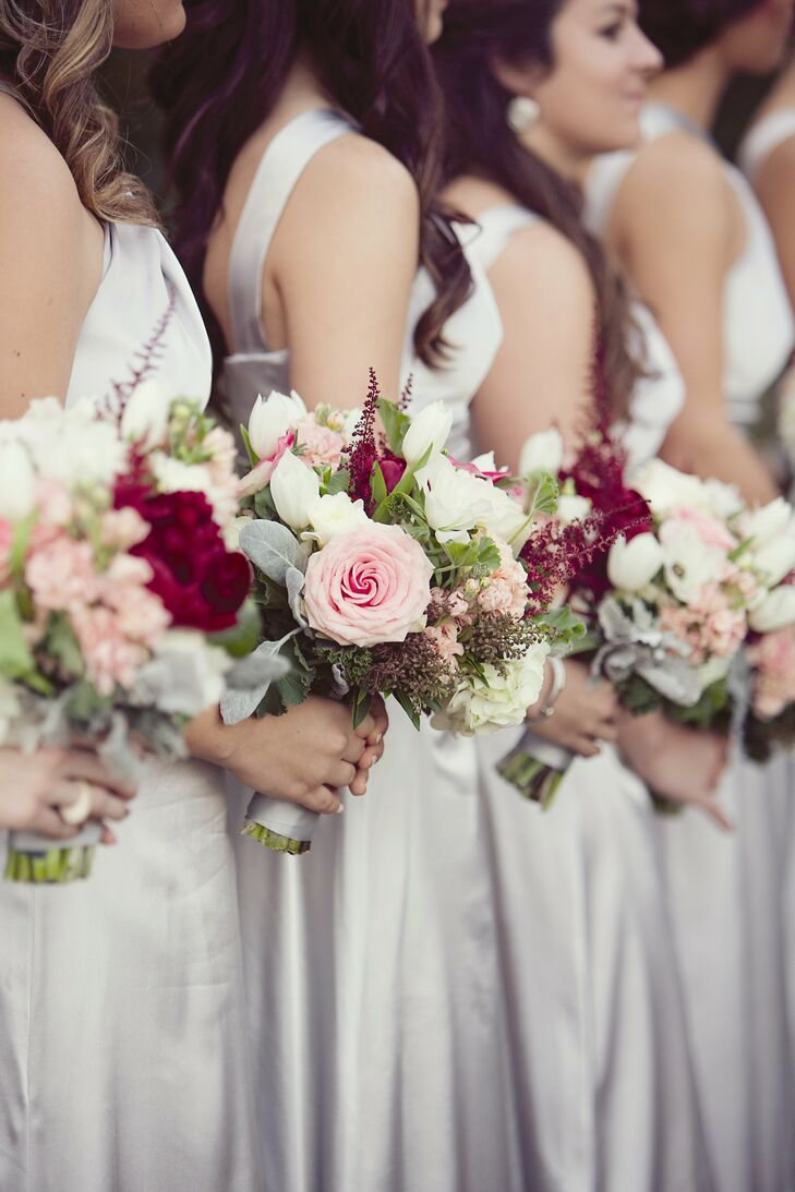 The bridesmaid bouquets were similar to the bridal bouquet, filled with bunches of tulips, stock, roses and white hydrangeas.