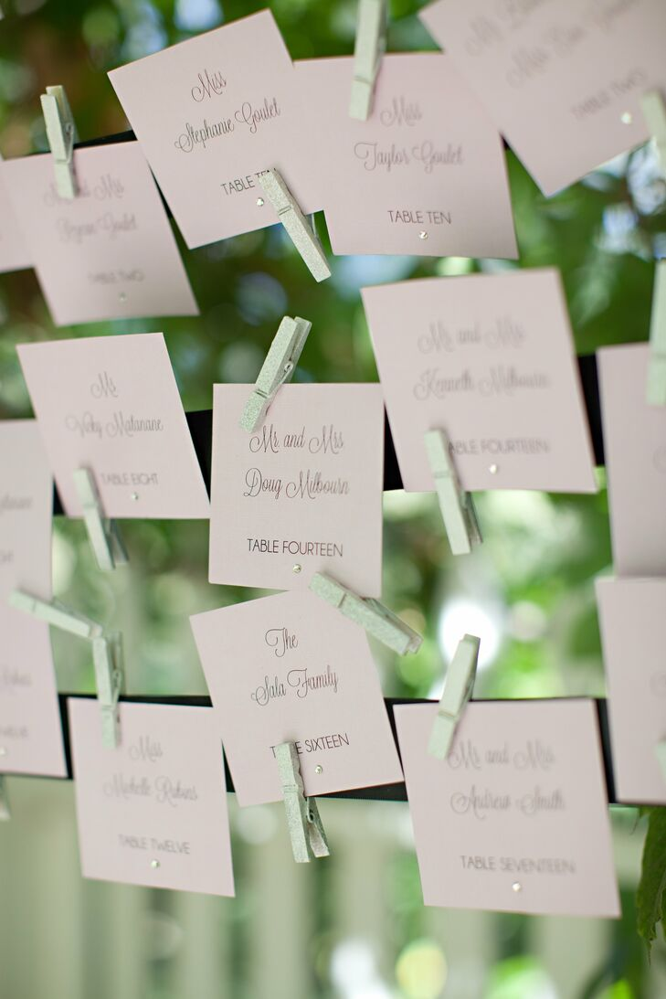 The off-white escort cards were attached to a wire display with tiny clothespins.