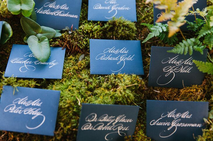 As guests arrived to the reception they were greeted by an impressive moss display with an earthy, organic feel, where they found hand-lettered escort cards leading them to their seats.