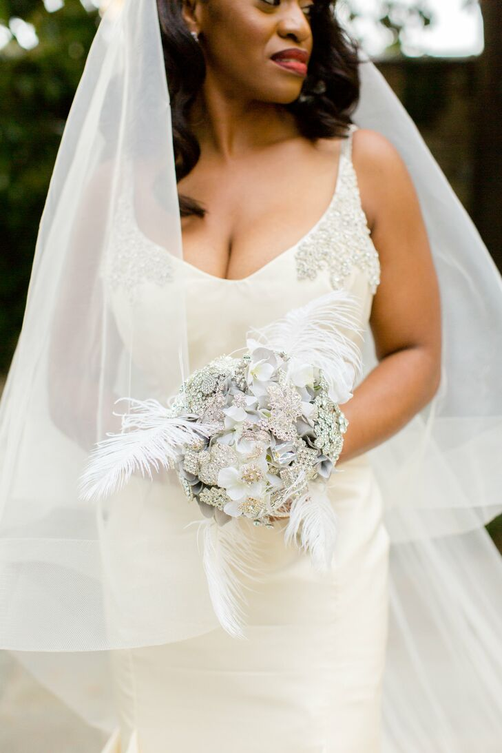 Bride with a White Bouquet with Feathers and Crystals