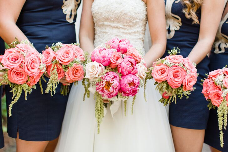 Flowers by On created incredibly fresh bridal party bouquets filled with coral flowers and hanging green amaranthus. Kelsey's bridal bouquet had lush pink peonies and spray roses, while her bridesmaid bouquets consisted of spray roses.