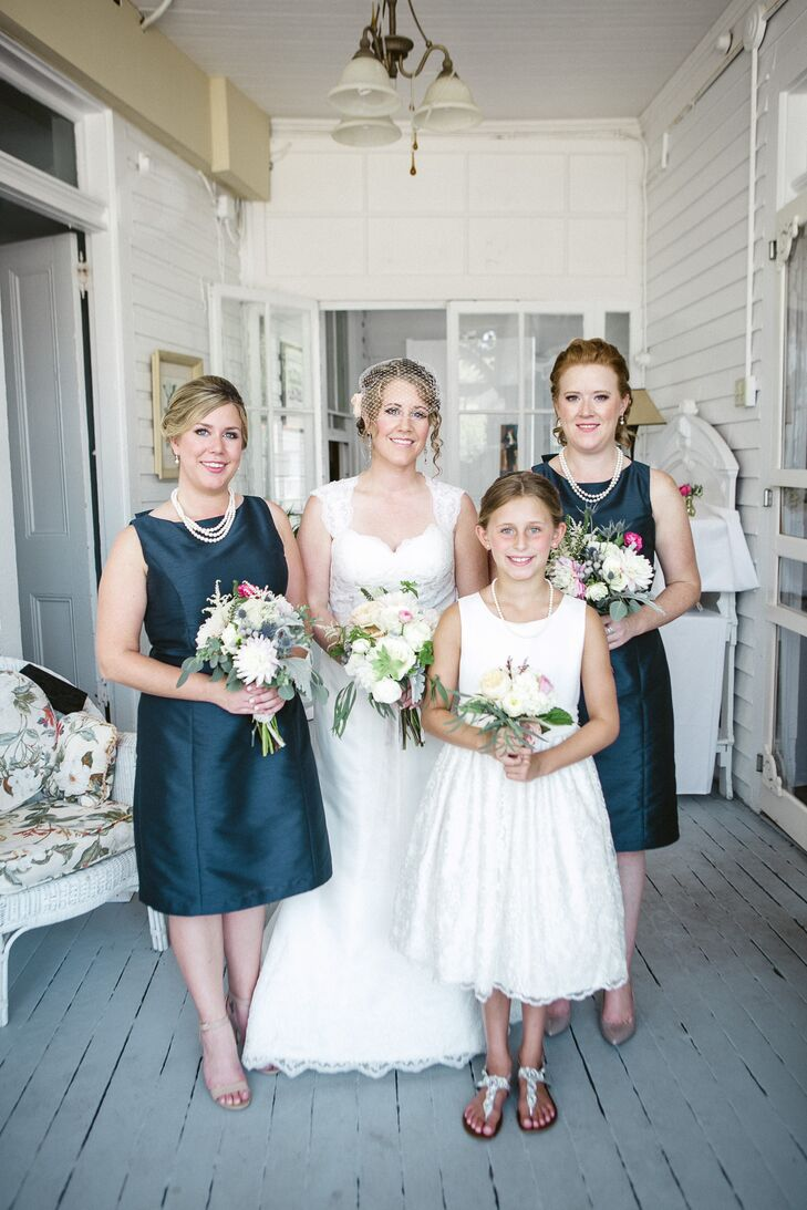 """When it was time to pick her bridesmaids, Catherine turned to two special people: her sisters. """"I told them I wanted something in a rich navy blue, knee length, elegant and traditional looking,"""" Catherine says. Both women picked  knee-length navy dresses with a high neckline and finished the look with a string of pearls from the bride."""