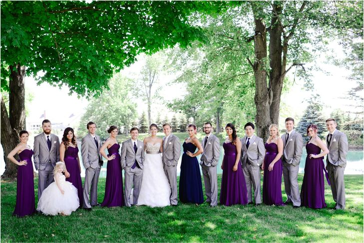 The bride and groom wanted a peacock-inspired wedding, but wanted to stick to the deeper jewel tones rather than focus on the blue and aqua colors in a peacock. The bridesmaids wore dark purple gowns and the groom and groomsmen wore complementary gray tuxes.