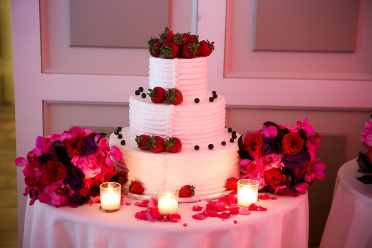 The three-tiered vanilla wedding cake was filled with fresh strawberries and Bavarian cream.