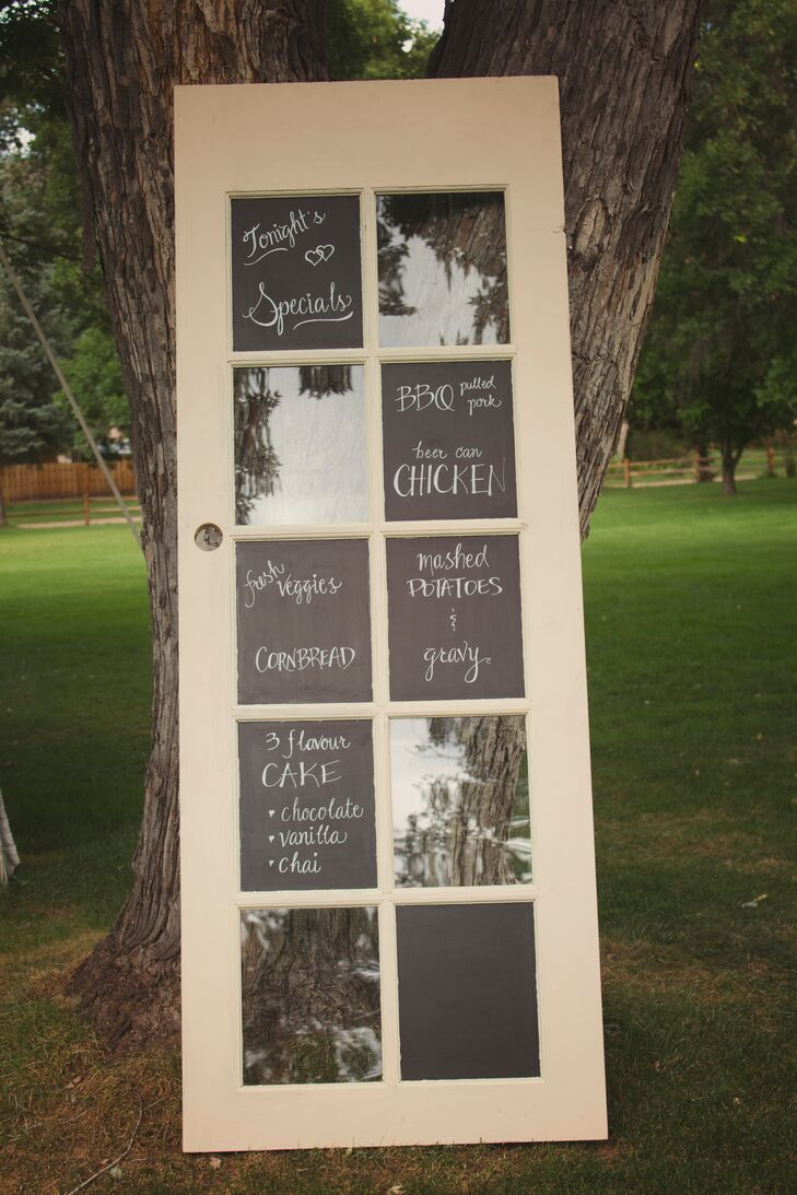 Milena and Gideon painted portions of an old glass door with chalkboard paint and wrote the menu on it for the reception.