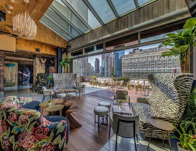 View of indoor and outdoor areas and boutique furniture from Monarch Rooftop.