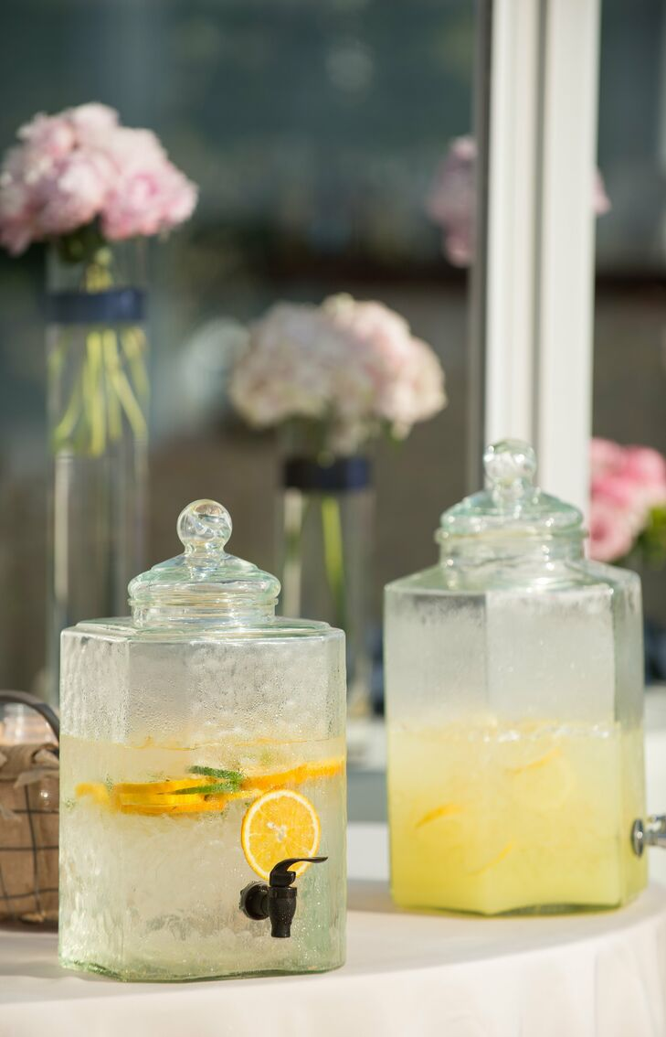 Large glass jars of icy lemonade and citrus-infused water kept guests hydrated during the sunny ceremony.