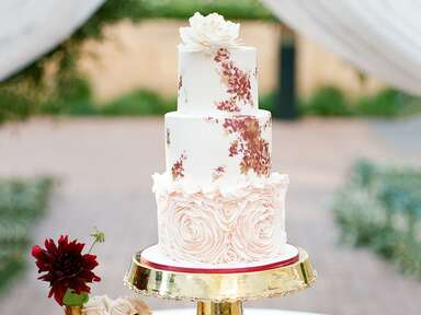 Handpainted wedding cake with rosette accent tier