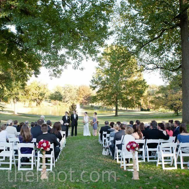Just before sunset, the couple exchanged vows in a serene cluster of trees overlooking the lake.