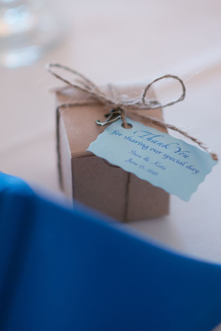 As a thank-you to their guests, Katie and Steve sent their friends and family members home with a few locally made sweet treats. The couple picked up sailboat-shape chocolates at Harbor Sweets in Salem, Massachusetts, and wrapped them in small brown boxes dressed up with miniature anchor charms.