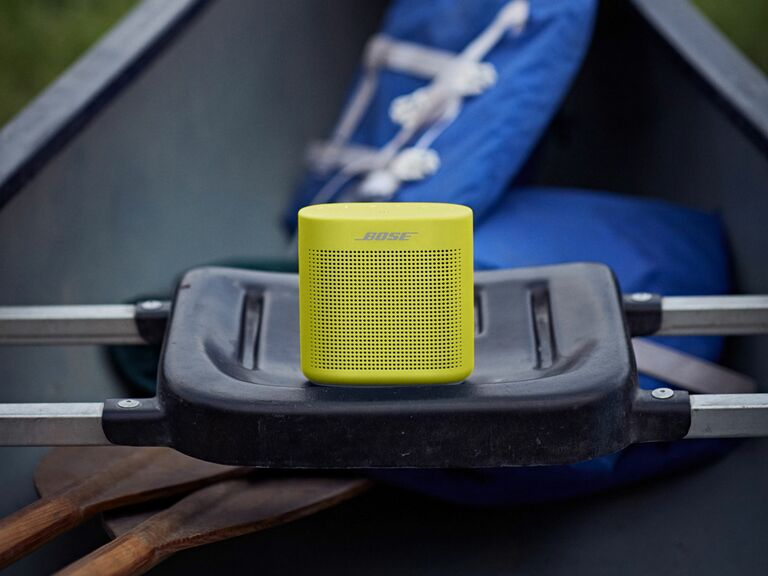 neon yellow speaker in small boat