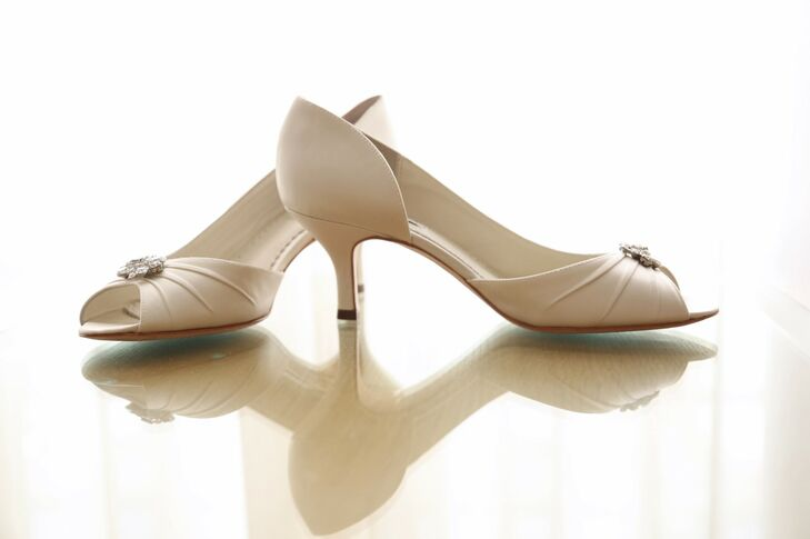 Samantha wore an open-toed pair of ivory shoes with a low heel on her wedding day. The tops of the shoes were accented with crystal detail.