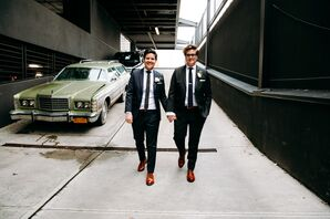 Brides Wearing Matching Suits and Brown Shoes