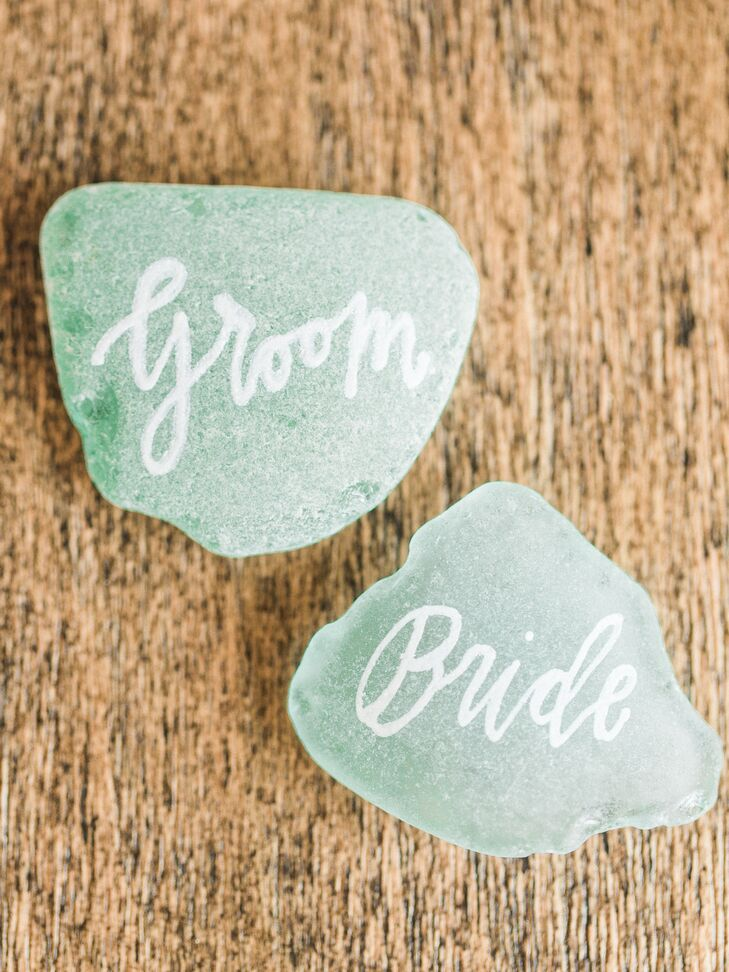 After ordering sea glass from Baltic Beach Treasures on Etsy, Allie Hasson hand-painted each guest's name on the glass.