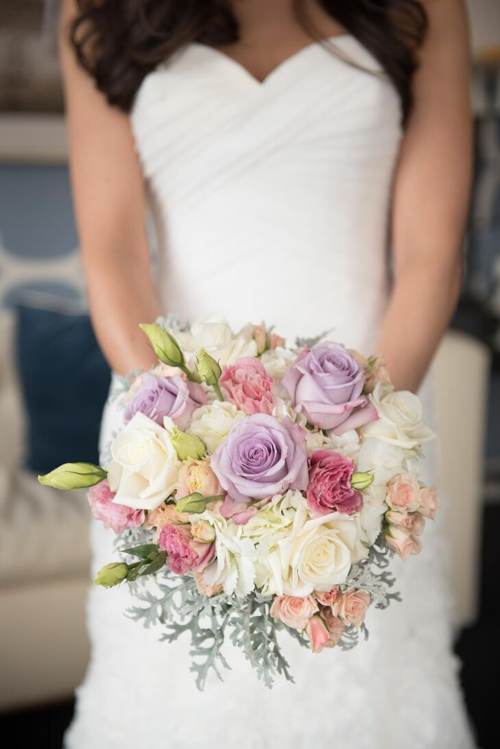 For a pop of color at her wintry event, Karen carried a pastel bridal bouquet. Flowers by Sweetens created this springtime-inspired flower arrangement that included lavender and ivory roses, pink carnations, ivory hydrangeas and peach spray roses as well as dusty miller.
