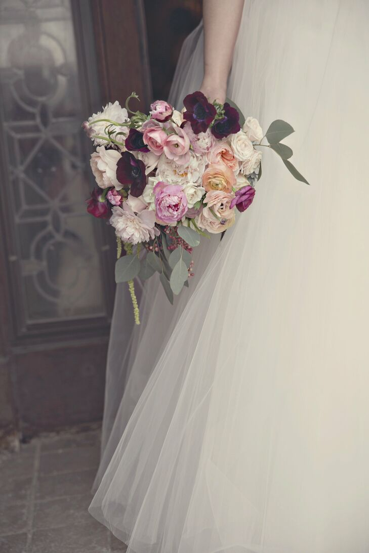 I wanted my bouquet to be very unconstructed and textured with draping pieces, says Emily. Her gathering of peonies, anemones, garden roses and ranunculus was a soft blush color with bold pops of burgundy to match the bridesmaid dresses.