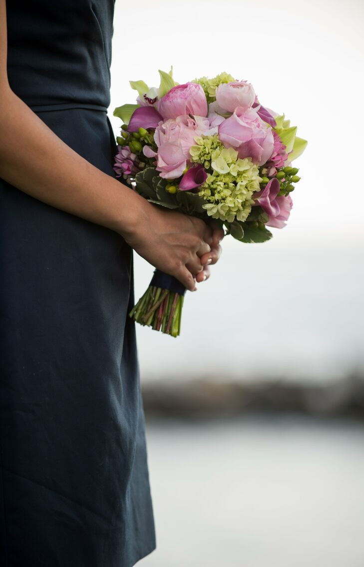 Green hydrangeas, orchids and hypericum berries were mixed with pink peonies, roses and freesias for elegant bridesmaid bouquets.