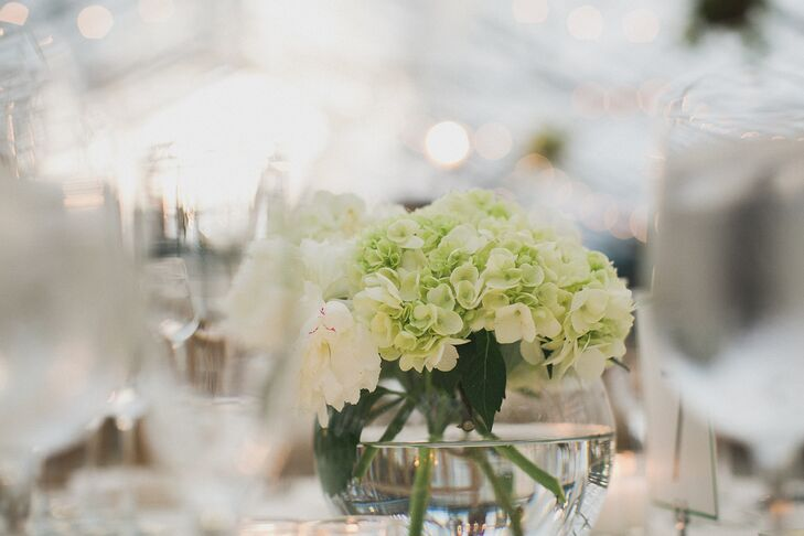 Since there was already so many leafy greens in the reception venue, Nicole and Adam kept their centerpieces simple with small arrangements of viburnum, roses and hydrangeas.