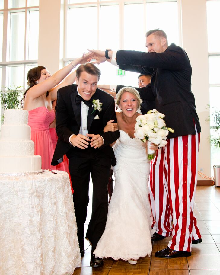 Aubrey and Jordan entered their wedding reception at Henke Hall of Champions in Bloomington, Indiana, through their bridesmaids and groomsmen joining hands high to form an arch. It was an adorable kickoff to the upbeat reception.