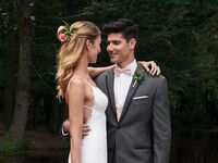 happy couple at their wedding day in a tuxedo and wedding dress
