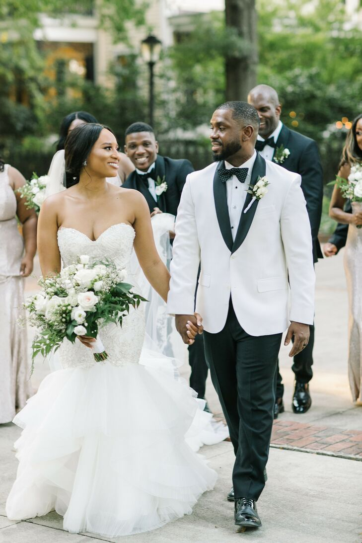"Courtney and Gerald's theme for their Columbia, South Carolina, wedding was, ""'A Night in the Gardens,' We wanted our wedding to focus on family and f"