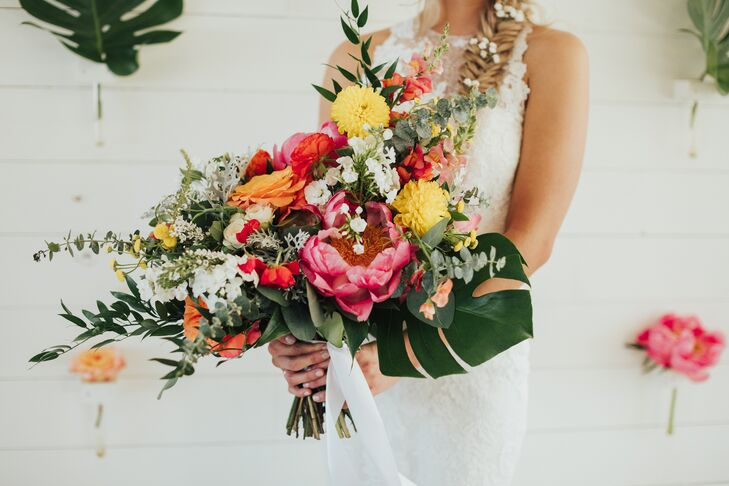 Petal Pushers created Jordyn's colorful, tropical-inspired bouquet, which included all of the day's colors—canary yellow, orange, pink and deep forest green.