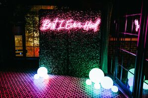 Modern Dance Floor with Greenery Wall, Neon Sign and Eclectic Lighting