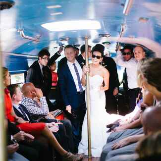 Bride and groom in a party bus